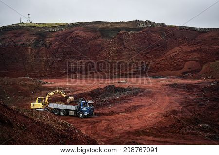 Stone mine of red stone in Iceland.