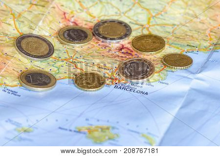 Spainish Euro coins are seen over map of Catalonia region in Spain. poster