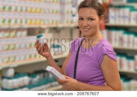 Portrait of a young woman choosing cream in store