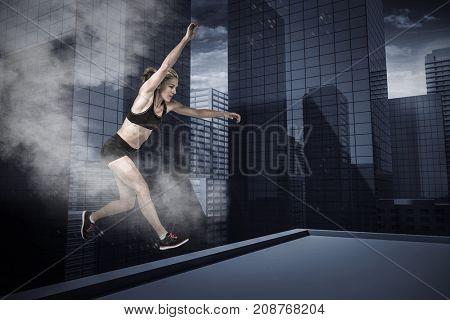 Athletic woman exercising on white background against splashing of color powder