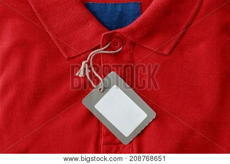 Close up red polo shirt with blank tags for sell at the shop
