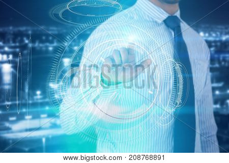 Mid section of businessman using invisible screen  against digital composite image of interface