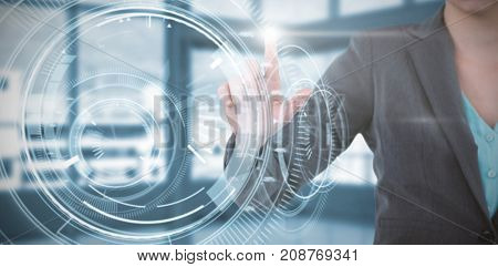 Businesswoman using invisible digital screen against interface dial with blue background