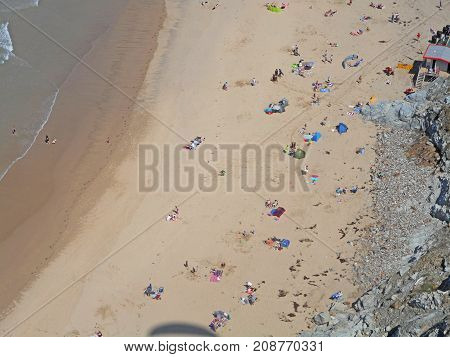 looking down on Perranporth beach from a paraglider