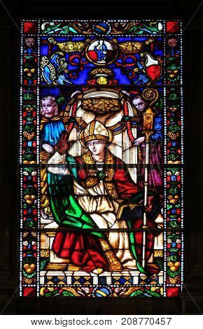 LUCCA, ITALY - JUNE 03: Stained glass window in the Santi Paolino e Donato church in Lucca, Tuscany, Italy on June 03, 2017.