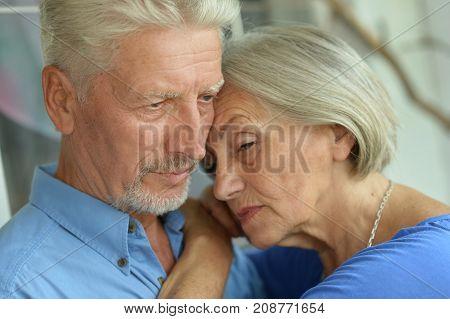 Close up portrait of sad senior couple