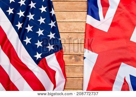 Uk Flag And Usa Flag On Wooden Background.