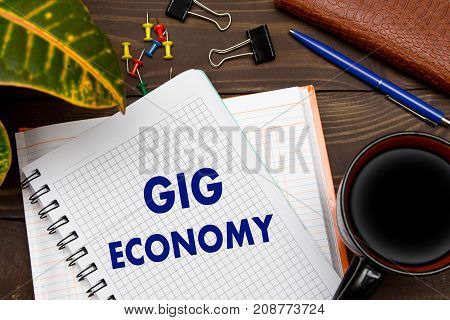 Notebook With A Notes Gig Economy On The Office Table With Tools. Business Concept