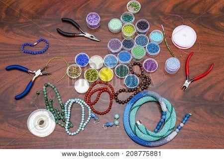 Making of handmade jewellery. needlework beads retro