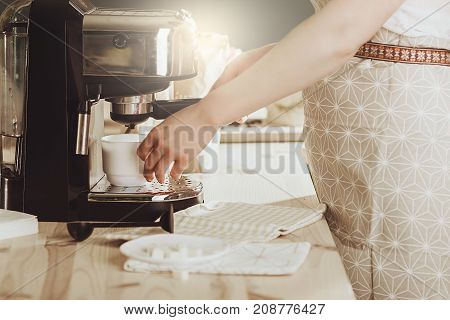 Woman Making Fresh Espresso In Coffee Maker. Coffee Machine Makes Coffee.