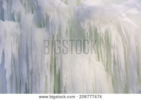 Background from a frozen waterfall of ice large icicles
