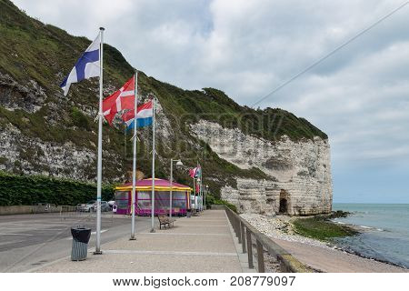 Boulevard with tent along the beach near the vertical limestone cliffs of Yport in Normandie, France