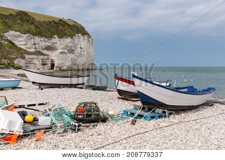 Fishing boats with fishing equipment at the beach near cliffs of Yport in Normandie, France