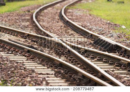 Old Railroad crossing, Two railway tracks merge at Station Lampang, Thailand.
