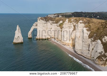 Famous elephant cliffs with people on top of it near Etretat in Normandie, France