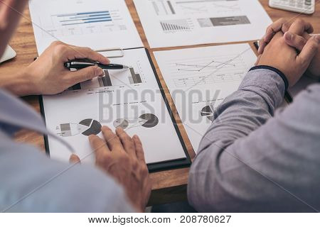 Image of executive businessman working consultation and conversation new business strategy plan in office with document data and report professional occupation concept.