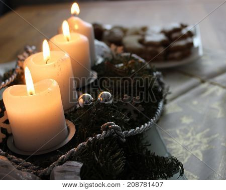 Christmas candles, advent decoration, four flames burning
