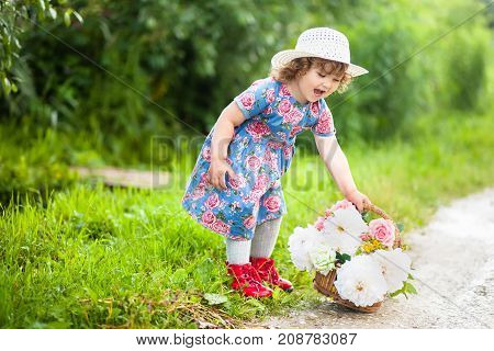 Toddler Girl With Basket Of Peony And Roses