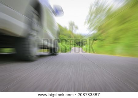 White car on the road with motion blur background.