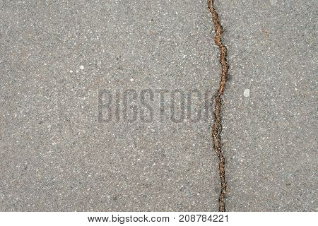 Crack on a concrete road, spring asphalt.