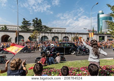 Madrid Spain - October 12 2017: King Felipe VI and Queen Letizia by Rolls Royce car at the end of Army Parade in Spanish National Day.