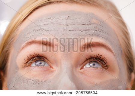 Closeup Of Woman Having Grey Mud Mask On Face
