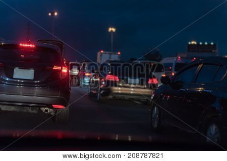 Row Of Cars With Traffic Jam On Toll Way At Night