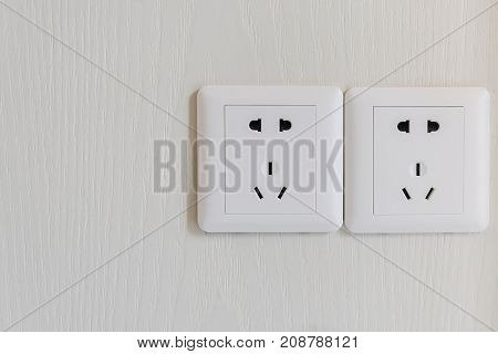 White Electric Plugs Or Outlet On Wall
