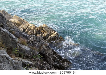 View of the sea. The waves break down on the coastal rocks. Summer. Balkans. Adriatic