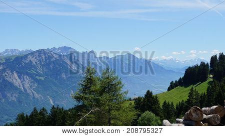 View from the Flumserberg in the canton of St. Gallen to the Swiss mountains, in the foreground wooden pile