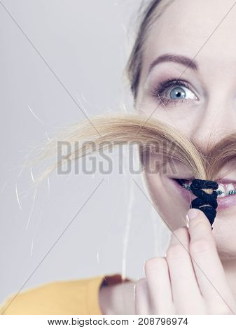Woman Making Moustache Out Of Blonde Hair