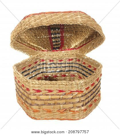 Empty decorative basket of hexagonal shape with an open lid isolated on white background.