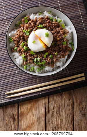 Japanese Spicy Beef Soboro With Egg Benedict, Rice And Green Onion Close-up. Vertical Top View