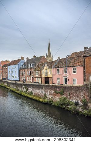 NORWICH, NORFOLK, 4TH OCTOBER 2017 - Colourful houses on the quayside of river Wensum as it flows through the city of Norwich Norfolk UK