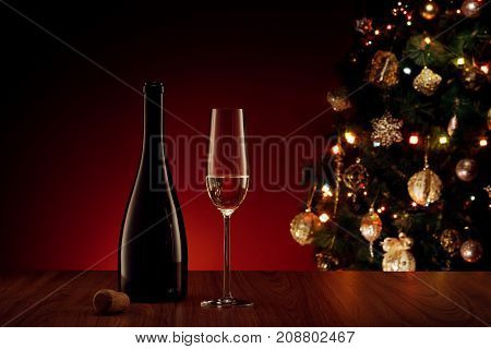close up view of champagne bottle with flute  color back
