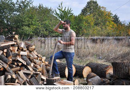 Tired lumberjack get rest. Lumberjack take a break after hard work