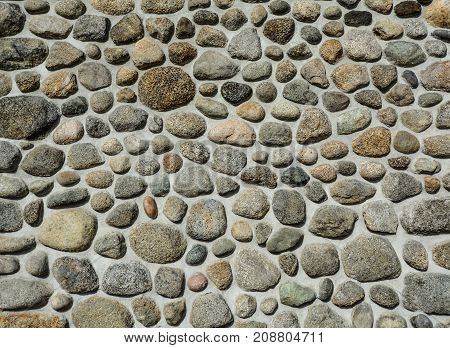 Stone mosaic texture background. A wall with rocks mosaic
