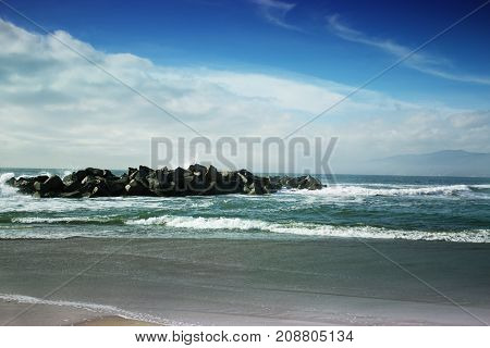 view of Venice beach California.Stormy ocean waves. beautiful seascape. big powerful tide in action.storm weather in a deep blue sea forces of nature natural disaster.