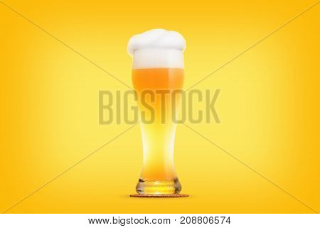 Glass pint of beer close-up with froth over yellow background
