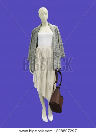 Full-length female mannequin dressed in fashionable clothes isolated. No brand names or copyright objects.