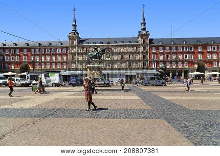 MADRID, SPAIN - MAY 24, 2017: This is the Casa de la Panaderia and the statue of King Philippe III in the Plaza Mayor.
