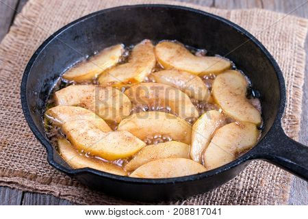 Cooking apple in a frying pan on the table