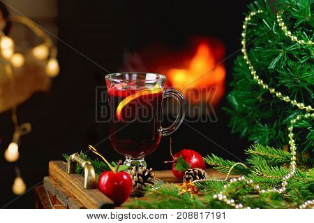mulled wine on a wooden tray with Christmas ornaments