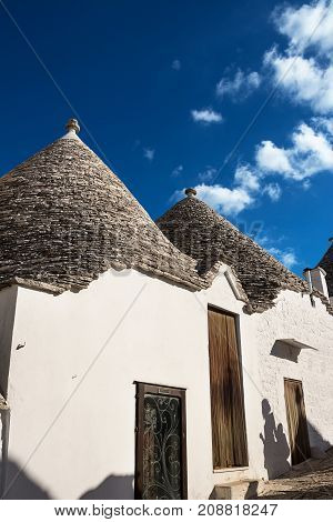 Typical Trullo of Alberobello with blue sky background