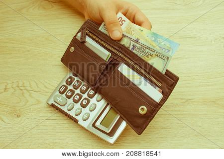image of man holding wallet with banknotes. Wallet with money concept of wealth - Retro color