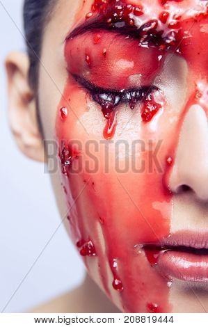 Portrait Of Beautiful Model. Red Jam Flowing Down On Her Face