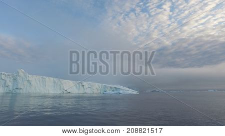 Massive iceberg on arctic ocean in greenland