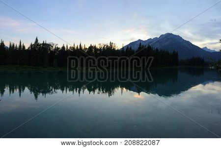 Banff, Bow River, evening reflection with mountain in background