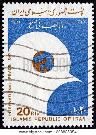 IRAN - CIRCA 1987: a stamp printed in the Iran dedicated to International Peace Day circa 1987