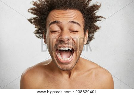 People, Body Language And Positive Emotions Concept. Emotional Pleased Amazed Mixed Race Uoung Male